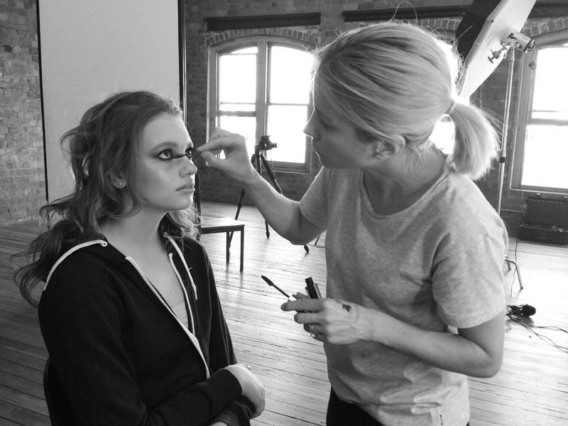 Zoe applying makeup in studio